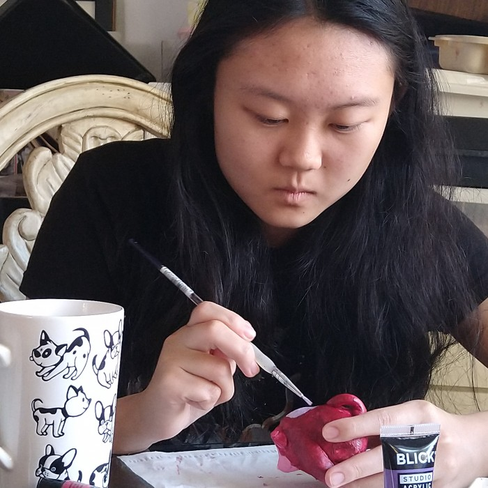 Write Girl Alyssa painting flower